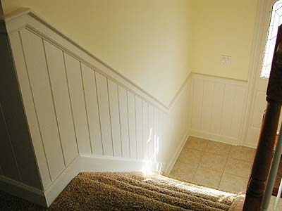 Looking Down At The Entry Door Landing, The Wainscoting Defines The Front  Entry And Leads Up To The Main Living Area.
